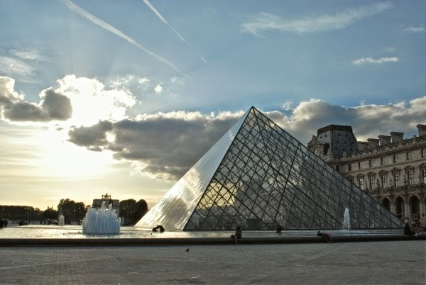 The pyramid of the Louvre in Paris, France at sunset