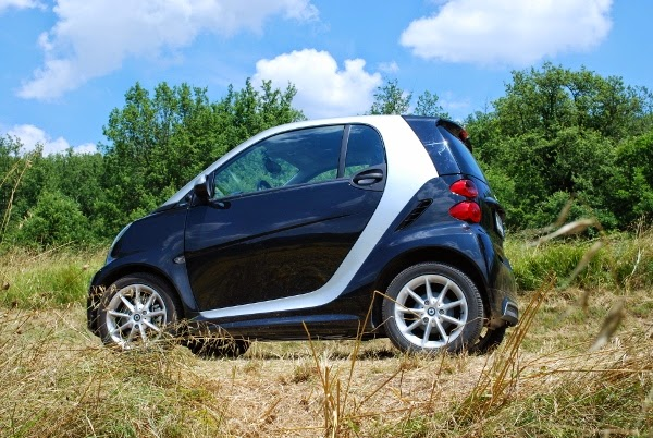 Our Smart Car on the Way to Sunflower Fields while Driving in Tuscany