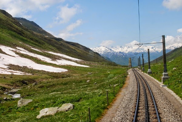 Trains in Switzerland with the Alps in the Background