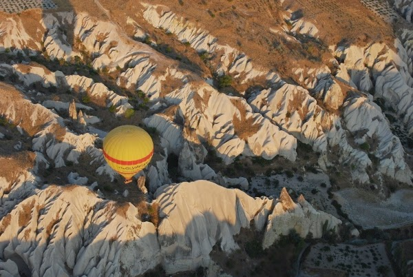 Hot air balloon and fairy chimneys in Cappadocia, Turkey