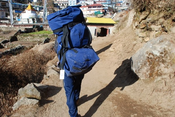 Hiking porter carrying our luggage on the Everest Base Camp trek.