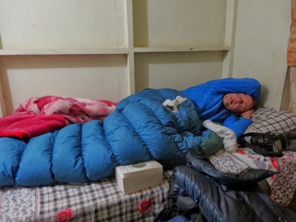 Pure exhaustion in a warm sleeping bag