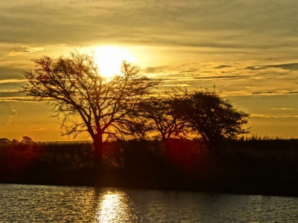 The sun sets in Africa, still gorgeous despite all the troubles