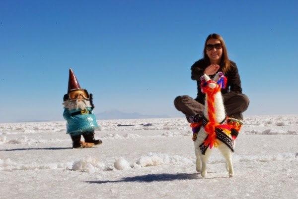 Angie riding her llama to work in Uyuni