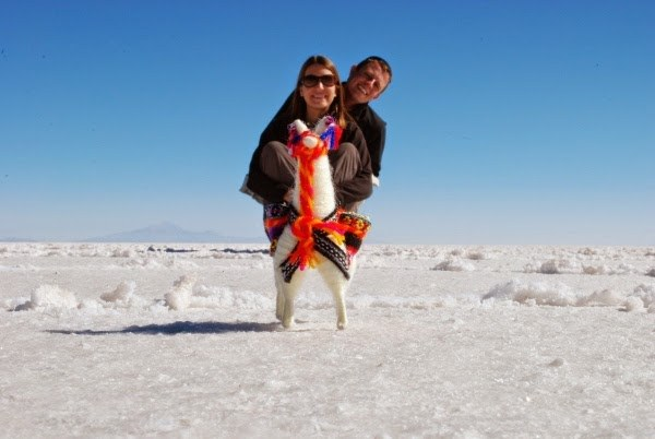 Jeremy and Angie riding a rather small looking llama in Uyuni
