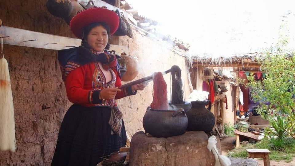 Woman in handicraft market in the Sacred Valley, Peru