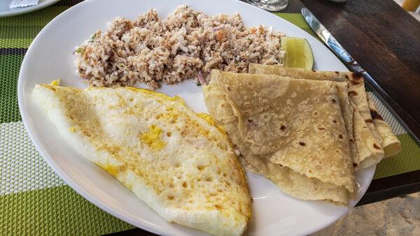 Maldivian breakfast of tuna, coconut, and chili with roti and egg